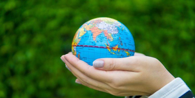 little globe in hands